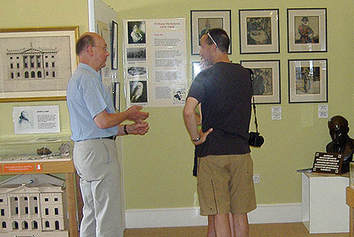 A volunteer showing a visitor round
